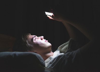 Boy in bed on phone.jpeg