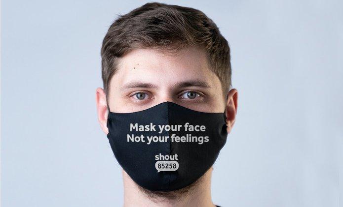 Young man mask writing.jpg