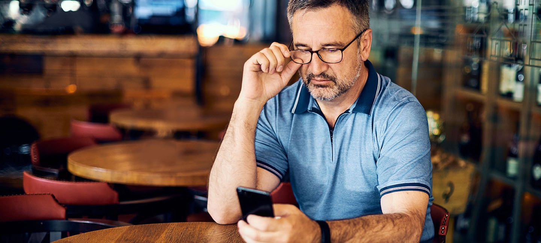 Older man texting.jpeg