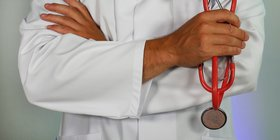 frontline worker holding stethoscope.jpg