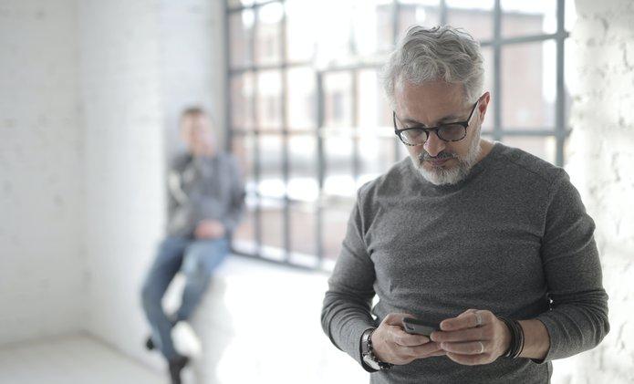 Older man texting.jpg