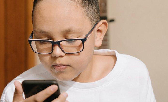 young boy texting.jpg