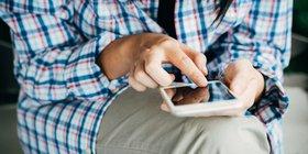 hand holding phone.jpg